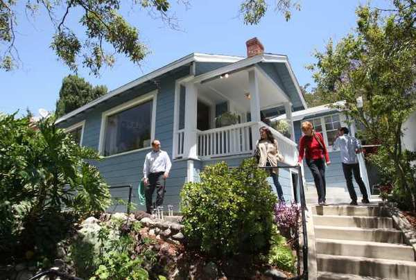 Real estate agents flock to a Highland Park bungalow going on the market earlier this year. The inventory of lower-cost homes, those that sell for $313,200 or less, has continued to shrink this year, leaving entry-level buyers scrambling.