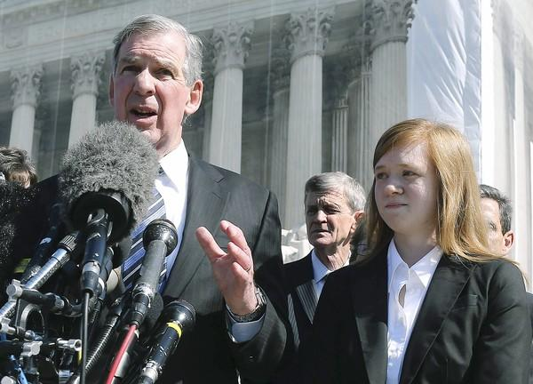 Attorney Bert Rein and client Abigail Fisher appear outside the Supreme Court after justices heard arguments in Fisher vs. University of Texas.