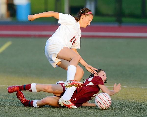 Whitehall's Dana Bartynski (13) bottom, collides with Parkland's Hannah Gombos (10) front, in the first half of their District 11 girls soccer championship game.