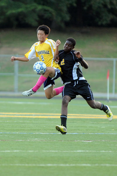 Catonsville's Daniel Kim, left, gets his knee ahead of Parkville's Udo Udo in the Comets' 5-0 triumph at Catonsville Wednesday evening.