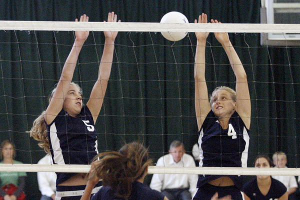St. Monica's Madeline Hagan, left, and Kristen Gates block attempt block a spike during a game against Le Lycee at Eagle Rock Recreational Center in Los Angeles on Wednesday, October 10, 2012.