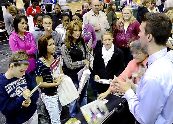 Students and parents listen to Gregory French, an admissions counselor at Frostburg State University, Wednesday during the annual college fair at Hagerstown Community College.
