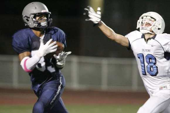 ARCHIVE PHOTO: Flintridge Prep's Chad Cosse, left, hauls in a reception over Chadwick's Cameron Bartlett.