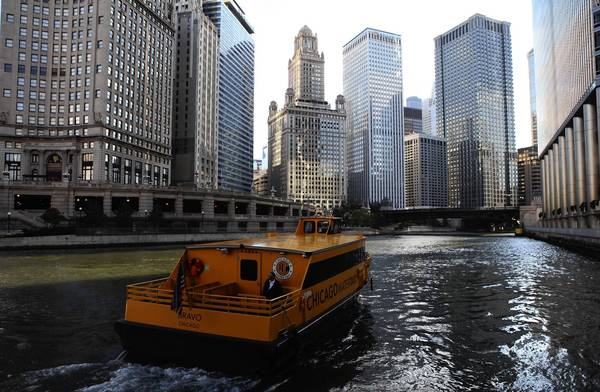 A Wendella Chicago Water Taxi travels down the Chicago River from the stop at the Wrigley building.  The company is celebrating their 50th Anniversary with free rides on Thursday, Oct. 11.