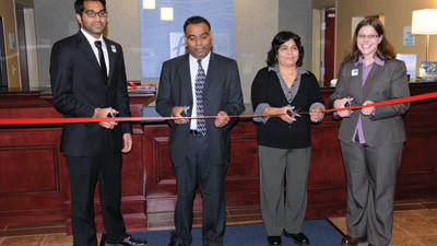 The Patel family and assistant manager Suzanne Magazzu cut the ribbon during the  dedication of the newest hotel in Somerset County, the Holiday Inn Express. The hotel is located at 132 Lewis Drive, near the Pennsylvania Turnpike interchange in Somerset.