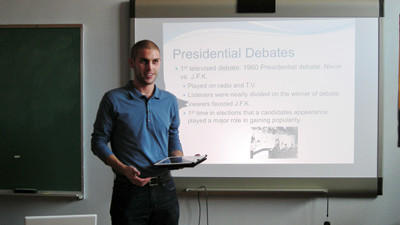 Berlin educator Westley Conn explains the aspects of the Presidential debate to his senior government and economics class.