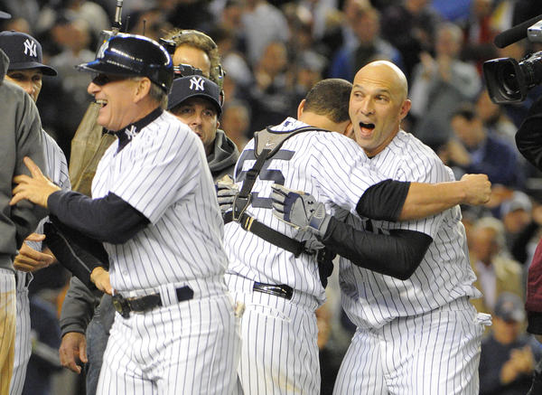 Yankees Raul Ibanez hits a game winning homer off Orioles' Brian Matusz in the bottom of the 12th inning, his second homer of the game. He is congratulated by teammate  Russell Martin. Baltimore Orioles vs. New York Yankees in game three of the ALDS at Yankee Stadium.