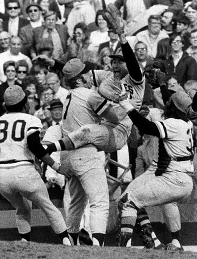 Pittsburgh Pirates starting pitcher Steve Blass, second from right, leaps into the arms of first baseman Bob Robertson after pitching a complete game to win, 2-1, over the Orioles in Game 7 of the World Series on Oct. 17, 1971. The Pirates' Roberto Clemente was named World Series Most Valuable Player after hitting two home runs in the series.