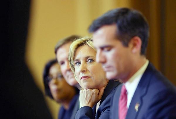 L.A. mayoral hopefuls, from left, Jan Perry, Kevin James, Wendy Greuel and Eric Garcetti listen during a candidates debate in September.