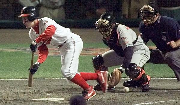 Cleveland Indians shortstop Omar Vizquel, left, failed to make contact on a suicide squeeze play in the bottom of the 12th inning in Game 3 of the American League Championship Series on Oct. 11, 1997. However, the winning run scored on the play as the Indians' Marquis Grissom raced home from third base when the ball got past Orioles catcher Lenny Webster, giving Cleveland a 2-1 victory.