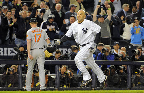 New York Yankees designated hitter Raul Ibanez, right, trots home after hitting a walk-off home run against Orioles relief pitcher Brian Matusz in the bottom of the 12th inning in Game 3 of the American League Division Series on Oct. 10, 2012. Ibanez hit a pinch-hit home run to tie the game in the bottom of the ninth, sending it to extra innings, where the Orioles lost, 3-2.