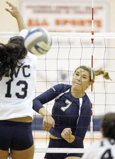 Orange Coast College's Karlee Riggs, right, scores a point as her shot goes past Irvine Valley's Avae Masaniai in an Orange Empire Conference match on Wednesday.