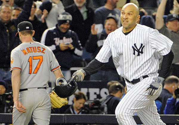 The Yankees' Raul Ibanez runs out his game-winning homer as Orioles pitcher Brian Matusz leaves the field in Game 3 of the American League Division Series in New York.