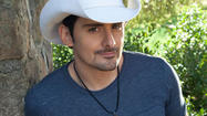 "<span style=""font-size: small;"">Brad Paisley and his pal Darius Rucker are teaming up with NASCAR brothers Darrelland Michael Waltrip to support the Waltrips' third annual Charity Championship with a big performance just outside of Nashville. Brad has many friends in the NASCAR world and he's even been behind the wheel a few times, himself...""I have done racing schools. And I do have a diploma or two from a couple of tracks…which has actually served me now way more than my actual college diploma has!"" All proceeds from the benefit will benefit Motor Racing Outreach and Feed The Children.</span>"