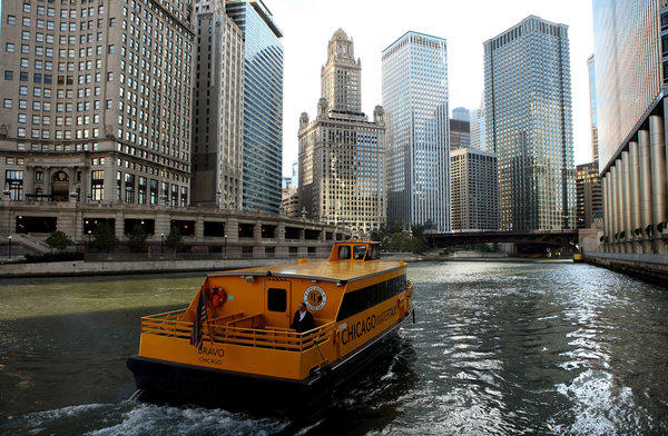 A Wendella Chicago water taxi leaves the Wrigley Building. With ridership expected to hit 400,000 by the end of the 2012 season, taxi service manager Andrew Sargis says the company may add a fourth boat and a stop near Goose Island next year.