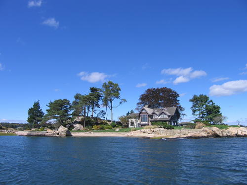 Tavern Island, a 3.5-acre island in the Norwalk Islands archipelago, was listed last week for $12.9 million. The asking price includes a mainland garage, parking and deepwater dock. The main house and beach are pictured here.