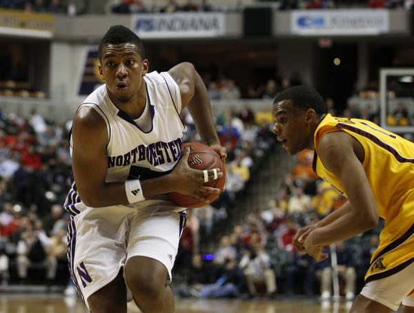 Northwestern guard JerShon Cobb drives past Minnesota guard Andre Hollins during their Big Ten tournament game last March in Indianapolis.