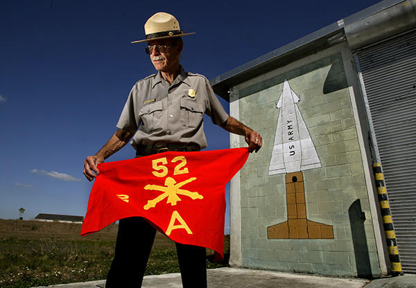The National Park Service has opened to the public the Nike Hercules Missile Base HM-69 at Everglades National Park. It's the first time people can tour the historic missile base since it was turned over to the park in 1979. Here, Everglades National Park Ranger Leon Howell holds the flag belonging to the U.S. Army, Battery A, 2nd Battalion, 52nd Air Artillery, stationed at the cold war era base. Behind him is a  mural of a Nike missile painted by one of it's members when the base was occupied.
