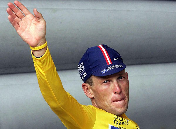 Lance Armstrong waves to the crowd during one of his victories in the Tour de France.
