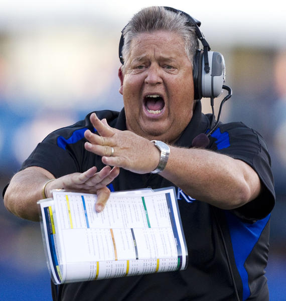 Charlie Weis calls for a timeout during Kansas' season opener against South Dakota State on Sept. 1.