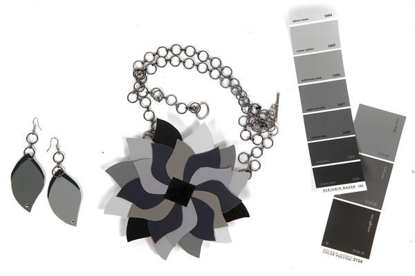 Michaels staffer Amber Voorheis offers these how-tos for the necklace she designed and made:<br><br>  1. Draw leaf-shape stencil on cardboard and cut it out.<br><br>  2. Trace stencil on the back of free hardware store paint chips in many shades of gray; cut out.<br><br>  3. Using 4-inch cardboard disc ($1.49) as base, attach one screw eye ($3.99 for 36) on opposite disc sides ¿ 180 degrees apart; Place glue on the screw first for extra security.<br><br>  4. Arrange petals in overlapping pattern as shown.<br><br>  5. Apply a thin layer of Mod Podge ($6.49, 8 oz.) to entire disc surface using foam brush ($.49); individually attach petals to disc with more Mod Podge.<br><br>  6. Cut to desired length; attach chain ($3.99, 4 feet) to screw eyes.<br><br>  7. Attach necklace closure (6 sets, $2.99).<br><br>