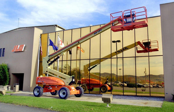 JLG Industries in McConnellsburg, Pa., manufactures aerial platforms such as this one reflected in the plant's window facade. Billionaire investor Carl Icahn is making an unsolicited bid for truck maker Oshkosh Corp., JLG's parent company.