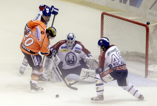 NHL Buffalo Sabres' player Vanek of Graz 99ers fights for the puck against KHL Medvescak Zagreb's Ouzas duirng their ice hockey match in Graz.