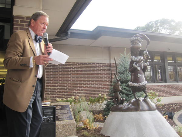Century Walk President W. Brand Bobosky dedicates the group's latest piece of public art, a Dr. Seuss-inspired sculpture at the Naper Boulevard Library.
