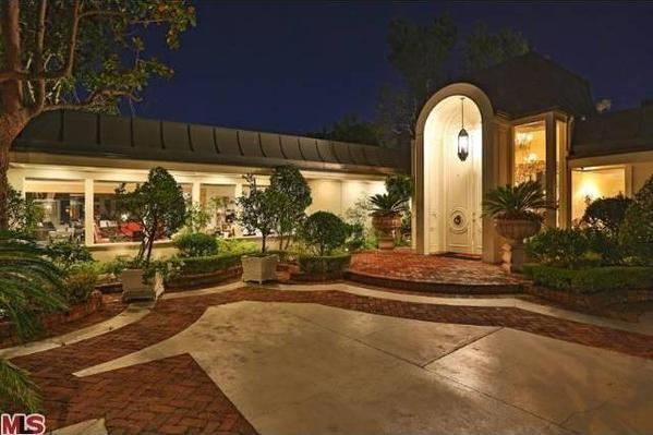 Elvis Presley's four-bedroom, five-bathroom estate in Beverly Hills sits on 1.2 acres.