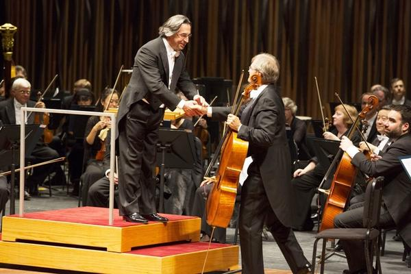Riccardo Muti shakes hands with cellist John Sharp following the orchestra's encore of Martucci's Notturno at Palacio de Bellas Artes theater in Mexico City.