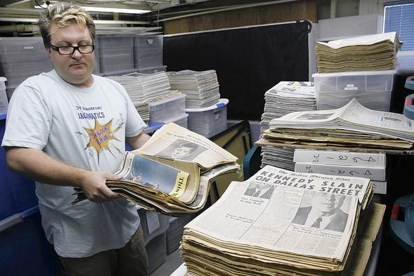 Christopher Kling has an extensive newspaper collection at his home in Laguna Beach.
