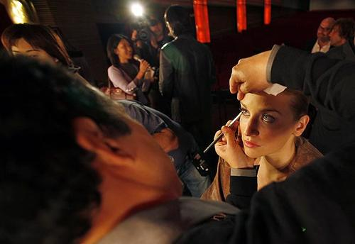 Model Brianna Barnes gets makeup from Bruce Grayson ahead of the Academy of Motion Picture Arts and Sciences' runway fashion show at its headquarters in Beverly Hills, showcasing competitors in this year's Oscar Designer Challenge, in which nine fashion designers vie to have an evening gown worn by an awards escort during the Oscars on Feb. 27. Members of the public are invited to vote to determine the winning design at <i>www.oscar.com</i>. Voting continues through Monday.