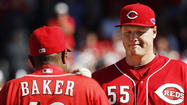Reds' manager Dusty Baker pulls Latos after Latos gave up a 5th inning grand slam to Giants Posey during Game 5