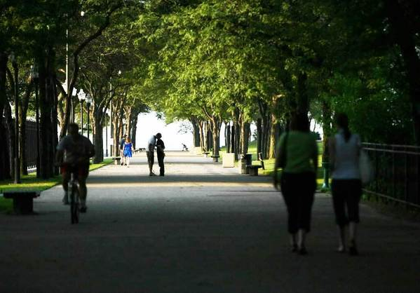 A couple takes a romantic stroll through Milton Lee Olive Park. Just west of Navy Pier, the park offers a quiet respite from the hubbub of one of the state's top entertainment destinations.