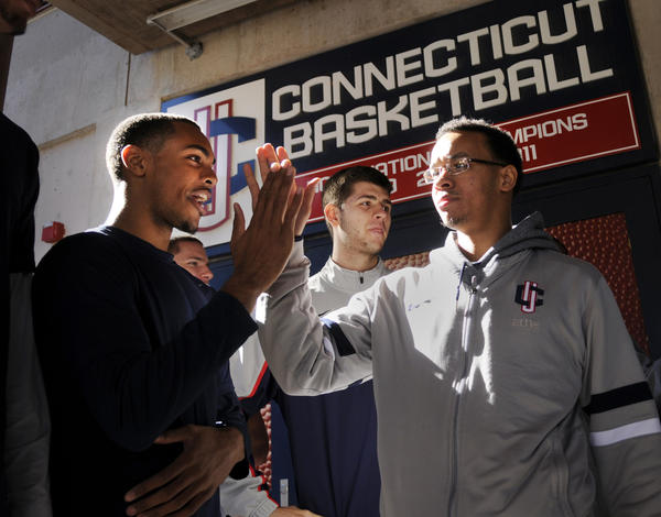 The kick off to the UConn men's basketball season began Thursday afternoon with the annual Husky Run outside of Gampel Pavilion. In photo, Brendan Allen left, high-fives teammate Shabazz Napier before the run.