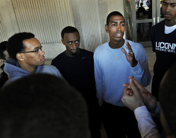 The kick off to the UConn men's basketball season began Thursday afternoon with the annual Husky Run outside of Gampel Pavilion. In photo, newly named head coach Kevin Ollie talks to heis team before the start of the run. At left is Shabazz Napier and at center is Ryan Boatright.