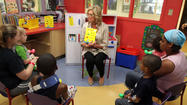 Ann Romney, spouse of Republican presidential candidate Mitt Romney, reads to children at the Chris Evert Children's Hospital