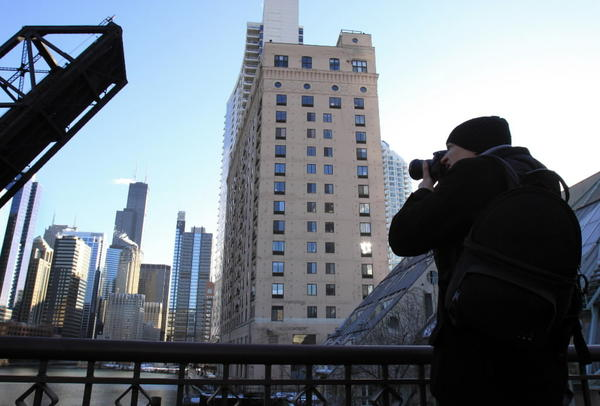 Julian Delebecque of France photographs the downtown skyline from Kinzie Street in the Fulton River District.
