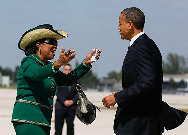 U.S. President Barack Obama is greeted by U.S. Rep. Frederica Wilson (D-FL) after arriving at Miami International Airport in Florida October 11, 2012.