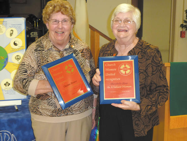 From left, Thelma Brewer and Marybelle Hose accept the Valiant Women Award from Church Women United of Washington County at its annual meeting.