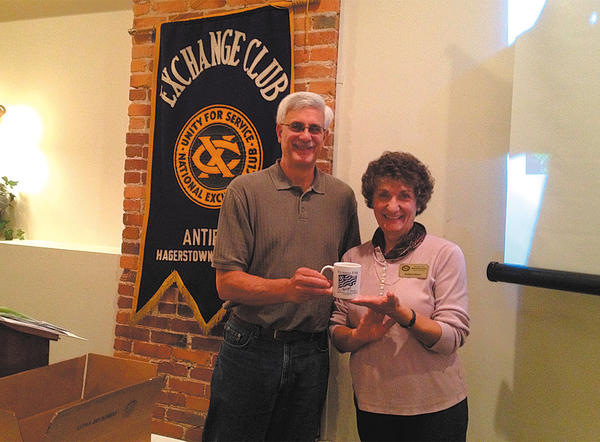 Antietam Exchange Club President Steve Bittner, left, presents a token of appreciation to Kathryn Henry, past president and board member of the Potomac Valley Audubon Society.