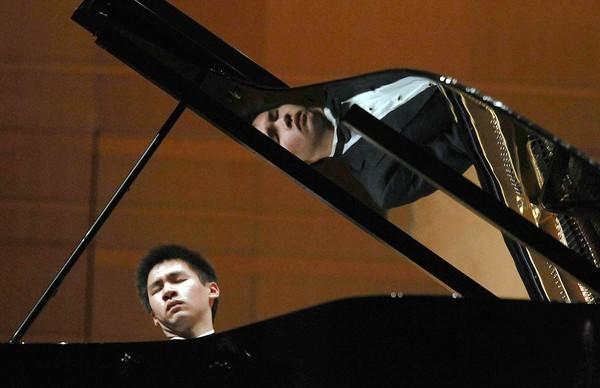 Pianist Conrad Tao plays with the Pacific Symphony during a concert last year at the Renée and Henry Segerstrom Concert Hall. Tao, 18, will be playing again with the orchestra Oct. 18-20.
