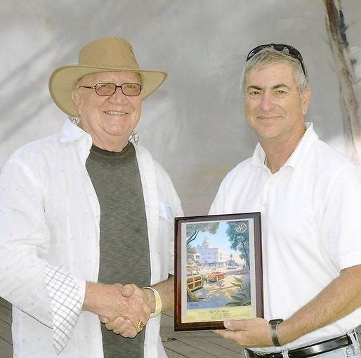 Rod Hatter presents the Best in Show award to Denny Grundy at the Classic Car Show on Sunday.