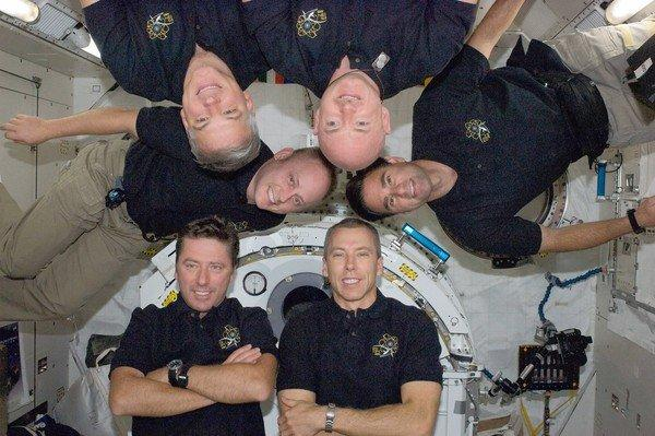 The shuttle Endeavour's final crew poses for an in-flight portrait in 2011. Commander Mark Kelly hangs upside down from the top at right; clockwise from him are Greg Chamitoff, Andrew Feustel, Robert Vittori, Mike Fincke and Greg Johnson.