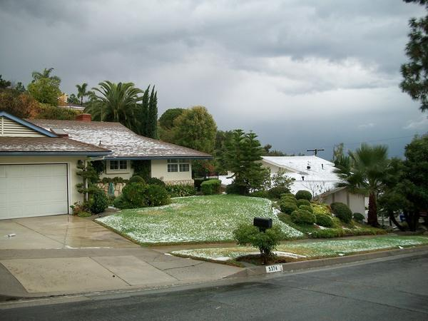 Ocean View Boulevard in La Canada Flintridge appeared a winter wonderland -- briefly -- after homes and yards were dusted by Thursday's hail storm.