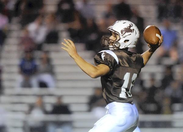 Catasauqua's Qb Zack Bradley (10) looks for an open receiver against Saucon Valley High School during their Colonial League football game.