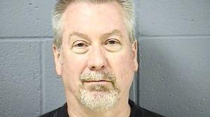 Drew Peterson attends mother's funeral