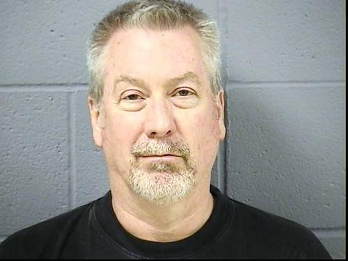 "This photo of <a class=""taxInlineTagLink"" id=""PECLB004315"" title=""Drew Peterson"" href=""/topic/crime-law-justice/crimes/criminals/drew-peterson-PECLB004315.topic"">Drew Peterson</a> was made available by the Will County Sheriff's Office after Drew Peterson was arrested for the murder of <a class=""taxInlineTagLink"" id=""PECLB203720374435"" title=""Kathleen Savio"" href=""/topic/crime-law-justice/crimes/crime-victims/kathleen-savio-PECLB203720374435.topic"">Kathleen Savio</a>."