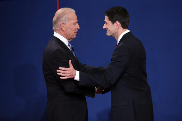 Biden and Ryan face off: U.S. Vice President Joe Biden, left, shakes hands with Republican vice presidential candidate U.S. Rep. Paul Ryan (R-WI) shake hands at the start of the vice presidential debate