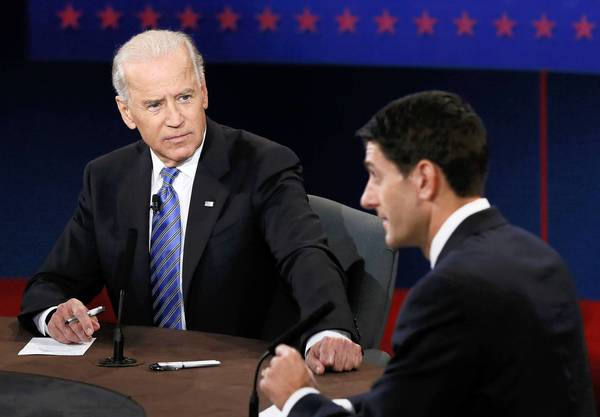 Biden and Ryan face off: U.S. Vice President Joe Biden (L) listens as Republican vice-presidential nominee Paul Ryan speaks